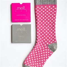 Socks + Chocs Gift Set from Melt Chocolates in the UK - They have collaborated with the British textile designer Catherine Tough, and commissioned gorgeous bespoke lambswool socks that coordinate with their delicious chocolate bars.  Hot pink with cream spot and soft grey trim. Melt Raspberry and milk chocolate bar + Melt dark chocolate Smoke Bar.