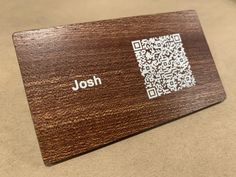 Mahogany wood business card with a QR code printed on it.