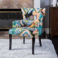 Add cozy classic style to any space with the Samuel Hermes fabric chair. This chair features beautiful multi-colored upholstery with dark finished legs that add a classy touch.