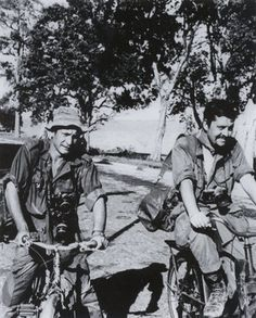 The Associated Press staff photographer Henri Huet, left, and Richard Pyle, A.P.'s Saigon bureau chief, on bicycles in Cambodia. 1970.