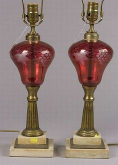 Pair of Cranberry Flash Glass Oil Lamps, England, late 19th century, each with etched leaf and berry design, fluted brass stems and Carrara marble square stepped plinths, ht. 14 in