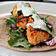 Succulent bites of Salmon Tikka wrapped in a wholewheat flat bread topped with Cucumber Raita!
