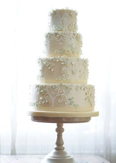 Fairytale wedding cake with bride and groom, cutout tree backgrounds and blue sugarpaste leaves and flowers
