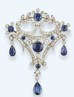 A belle epoque sapphire and diamond brooch   The kite-shaped openwork panel set with brilliant-cut diamond scrolls and millegrain-set sapphire accents and central motif, suspending pear-shaped sapphire triple drops, circa 1905, detachable brooch fitting by chrystal