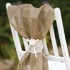 Natural burlap wrap with lace, highlighting an ivory satin bow and rosette with pearl accent. Use as a bouquet wrap, napkin or table top decoration. Pair it with the Rustic Country Wedding Collection