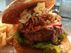 The Big Squeal: 1/2 lb beef pulled pork bacon cole slaw crispy onion strings smoked gouda lettuce pickle and BBQ sauce. (1086x880)