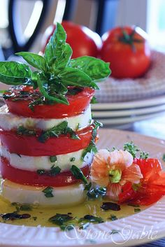 APPETIZER - 'Caprese' Tower - layers of mozzarella & tomatoes topped with basil.  I would probably add a thin layer of pesto in between each layer or just a dollop on to top.