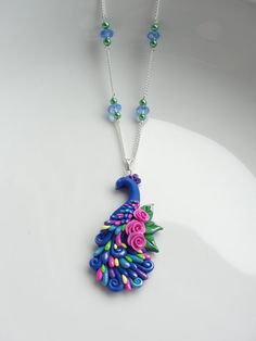 Blue peacock necklace made from polymer clay by fizzyclaret