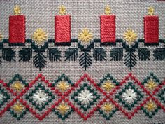 Kreinik Silk Serica is used to make the candles in this Evergreen Sampler