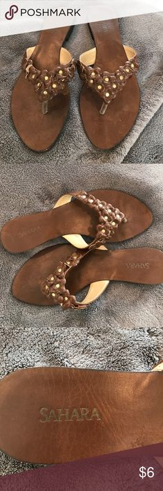 Sahara Brown leather flip-flops Like new maybe worn once or twice as you can see from the picture of the soles. Sole and strap say they are a 9 but I wear an eight in flip-flops and these brown flip-flops fit me just fine. They run small I would say  size 8 sarah Shoes Flats & Loafers