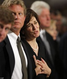 Widow Vicki Kennedy stands next to her step-son Ted Kennedy Jr at the Roman Catholic Funeral Mass for Senator Edward Kennedy at Our Lady of Perpetual Hope Basilica in Boston after he died of cancer aged 77 in 2009
