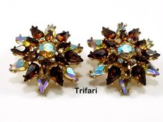 Excited to share the latest addition to my #etsy shop: Crown Trifari Amber Topaz Aurora Borealis and Chaton Marquise Rhinestone Clip Earrings 1960s - Signed Crown Trifari - Star Crystal Earrings https://etsy.me/2GJ6UXM #jewelry #earrings #rainbow #auroraborealis #amber