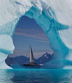 """Irish adventurers return from Arctic with stunning photos, mild sea-sickness * The eleven person team – ranging in age from their early 20s to early 60s – are back on dry land after an epic voyage to Greenland and a turbulent return sea journey that """"put manners on everybody"""". * The 'Killary Flyer' photographed through an iceberg arch (Daragh Muldowney) --- (I dislike them for wearing seal skin, though!!!)"""