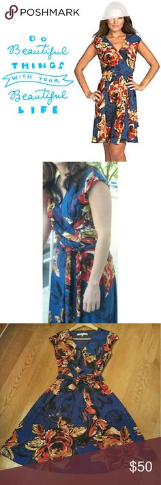 """Evan Picone Tropical Floral Wrap Dress The most flattering wrap dress Ive ever owned! Unfortunately, I outgrew the bust so it's time for someone else. to enjoy it! Tropical floral pattern on a cobalt blue background is perfect for summer parties & beach outings! Easy wrap style adjusts to your size. Generous long self-tie sash belt can be tied in back or front. Deep V Neckline. Knee length. Cap sleeves. Light, stretchy jersey material.   {Measurements} Bust: 18"""" Waist:15"""" Length: 36""""…"""