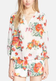 Pairing this floral print silk blouse with lace-up gladiator sandals and a stacked wrist for an effortless yet chic summer vibe.