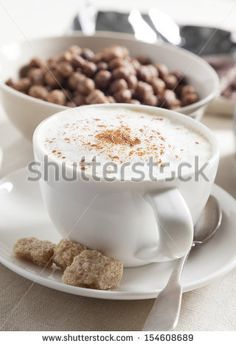 The morning breakfast of chocolate cornflakes, coffee, cappuccino and chocolate.