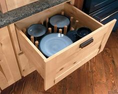 Peg drawers for plates & bowls - Schuler Cabinetry Kitchen Drawer Inserts, Kitchen Drawer Organization, Kitchen Storage Solutions, Kitchen Drawers, Kitchen Cabinets, Hickory Cabinets, Kitchen Organizers, Craft Organization, Craft Storage