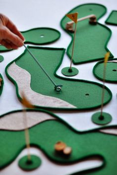 Make the most of your snow days this winter by making this clever DIY table top mini golf game from Oh Happy Day!