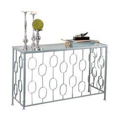 "Glass-topped console table with an openwork metal base.     Product: Console table Construction Material: Glass and metal   Color: Silver   Dimensions: 30.5"" H x 48"" W x 16"" D"