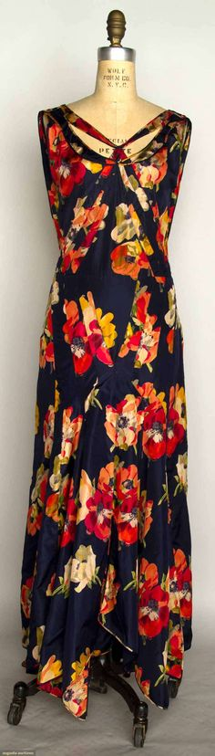 1930 printed taffeta evening gown: navy blue silk w/red poppy print, cut-out F neckline, bias cut, and handkerchief hem.