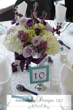 purple wedding flowers for a wedding reception centerpiece by AntebellumDesign.com