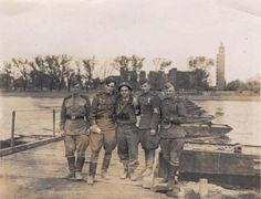"May 1945 Elbe River at Magdeburg, Germany. Here are those famous ""Ruskies"" hat you've heard so much about. That's a Russian Lieutenant that I am holding up. Army Uniform, Red Army, United States Army, Military Equipment, We Remember, World War Ii, Ww2, Germany, Painting"