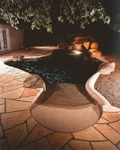 Favorite pool design... Imitation shoreline into a small lagoon shape.