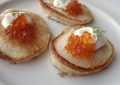 Blini with red caviar, sour cream and dill