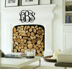 Use a large vinyl monogram to fill the void on a huge blank fireplace