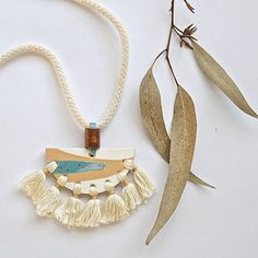 fringe necklace on rope with possibly ceramic?