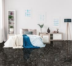 The delicate veined pattern of marble-look is always elegant and in style. Use a large format black floor tile and offset it with white linens and vibrant blues. White Linens, Black Floor, Amazing Spaces, Large Format, Black Marble, Design Trends, Tile Floor, Tiles, Vibrant