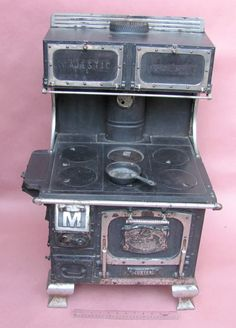 wood burning cook stove ..  Grandma cooked on one http://www.antiqbuyer.com/images/ARCHIVE_PICS/PM-SS/AAA_Stoves/Majestic2/IMG_4294.jpg