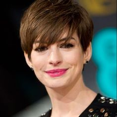 Anne Hathaway looks like Ashton Kutcher with makeup and a new hair style. Lol!!