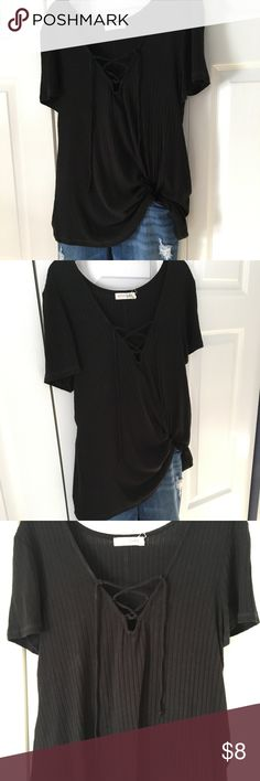Lace up ribbed black  shirt Pictures don't do it justice because my phone camera distorts the color and texture! This shirt has been worn one time and was purchased at marshalls. Stretchy and flowy material to fit well. live to be spoiled Tops Blouses