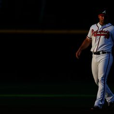 Dan Uggla #26 of the Atlanta Braves waits on a play against the Colorado Rockies at Turner Field