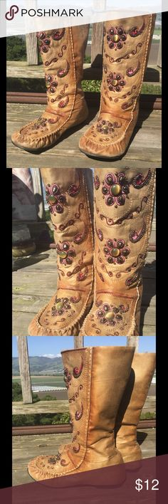 Tan jeweled moccasin boots Tan moccasin boots with many jeweled decorations along the front in swirling, flower shapes. Gently used Shoes Moccasins