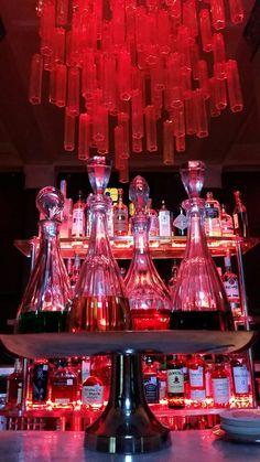 Pink cylinder lighting above bar area inside St Anthony Hotel restaurant  #pink #sanantonio