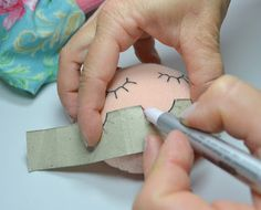 Mark the eyes and mouth of your dolls with a fine tipped pen and a template to always have the perfect stitch everytime