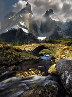 Torres del Paine National Park, Patagonia, Chile. Bridge and snowy mountain pass. Majestic.