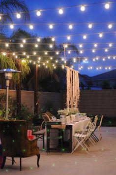 Lights + pretty chairs + random pretty plates + simple table cloth + flowers= pretty instant backyard party
