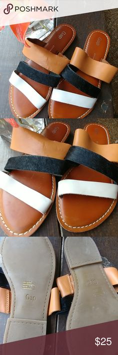 Gap leather flat sandals New without tags, beautiful tan black and white colors, Look at second picture, it has a little fading probably it will go away with a leather cleaner wipe, never used have bee sitting in my closet. True to size GAP Shoes Sandals