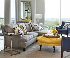 Patterned pillows add fresh style to this condo living room. See the rest of this modern condo: home design house design room design design ideas decorating Living Room Grey, Home Living Room, Living Room Designs, Condo Living, Blue Yellow Living Room, Yellow Rooms, Yellow Walls, Living Area, Decoration Gris