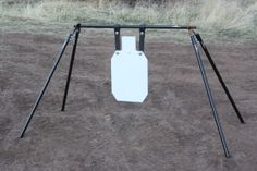 Rogue Shooting Targets - Large Swinging Gong Stand with x scale IDPA Silhouette Steel Shooting Target x www. Metal Shooting Targets, Shooting Guns, Shooting Sports, Steel Targets, Steel Target Stands, Reactive Targets, Shooting Table, Bow Target, Shooting Practice