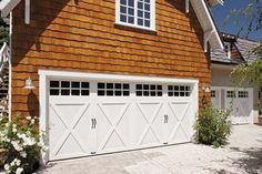 GATE4LESS Coachman Collection garage door with arched windows and colored overlays. Choose yours: http://gateforless.com/product-category/gate/residential/wood/coachman-collection/