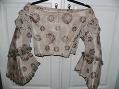 """1860's Civil War Silk Bodice with Pagoda Sleeves, ebay seller avivb, this estate had another bodice in this same fabric; piping at neck; hem & shoulders are piped except where bodice was taken apart; one stay is under the back eyes, lined with cream cotton, sleeves partially lined in cream silk; back hook & eye closure; bust: 30""""; waist: 24""""; length: abt 21"""", no underarm discoloration"""