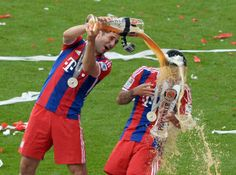 Apparently in Germany it's a beer shower… Bayern Munich players celebrating winning the Bundesliga.