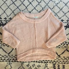 Soft pink doleman sleeve sweater Super cute aloft pink boat neck sweater featuring slight high low waist line and doleman sleeves. Hardly worn and perfect for the cooler weather without being bulky. Size small. Kimchi and blue is the brand. Only one small snag. Shown in 4th photo. Not noticeable when on. Urban Outfitters Sweaters Crew & Scoop Necks