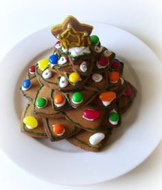 Makes 1 tree I am in the grip of a serious gingerbread fetish this yuletide and this Christmas cookie tree ticks all the boxes. I had a 10 piece cookie cutter kit, but you could make your own temp…