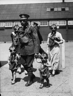 A soldier escorts two young visitors to the gas chambers during an open day at Kingston Barracks in Surrey. (Photo by Keystone/Getty Images). June 29, 1935 [The use of poisonous gas in war brings up the issue of ethics in battle and the so-called laws of war. Click on this image to see a clip and short analysis of just and unjust wars from a sociological perspective]