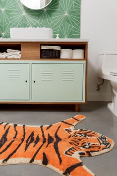 Talk about impressive IKEA hacking: The firm took a classic IKEA PS metal cabinet, painted it in a retro hue, and built a wood structure to create a c. Ikea Ps Cabinet, Ikea Cabinets, Country Style Bathrooms, Chic Bathrooms, Tiger Rug, Old Coffee Tables, Look Retro, Geometric Tiles, Ikea Bathroom